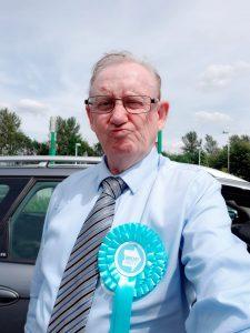 Rev Ross Rennie wearing Brexit Party rosette
